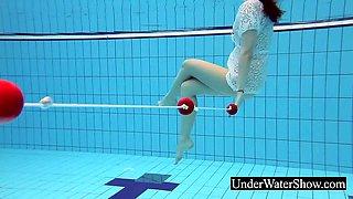 Slim redhead in the white dress underwater
