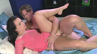 Brunette Milf bangs big cock in bed