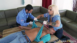 Tattooed blonde Lylith Lavey, wearing cop uniform, enjoys anal sex
