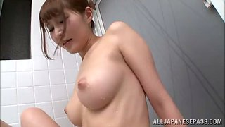 affectionate solo model with natural tits fingering her pussy in the bathroom