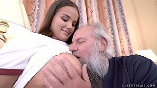 Busty Hungarian teen Olivia Nice gives a good blowjob to old pervert