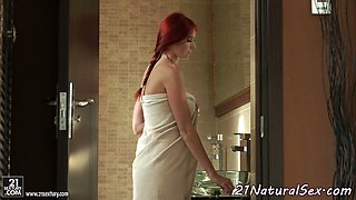 Redhead beauty masturbating after showering