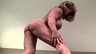 Female Bodybuilder Shows Off Her Big Clit