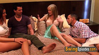 Married couple enjoys pre party activity with other swingers