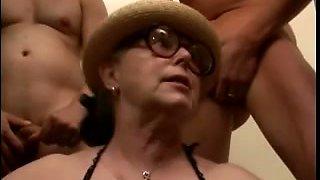Granny with vintage round glasses sucking dicks of men