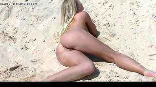 beach beauty posing in tiny bikini part 2