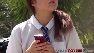 Cute japanese schoolgirl taped up skirt outdoors
