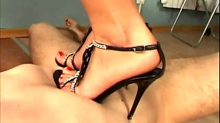 Young sister is trampling her brother, makes him suck her heels on her shoes