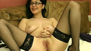 Seductive foureyed babe in nylon stockings masturbating in amateur video