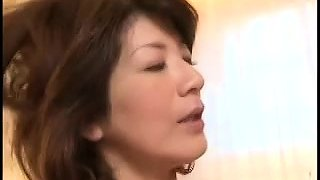 Horny Oriental housewife enjoys the pussy pounding action