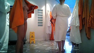 Girls in changing room are in bath robes and also naked