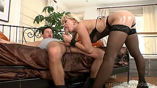 Sizzling blonde in black stockings gets fucked from behind
