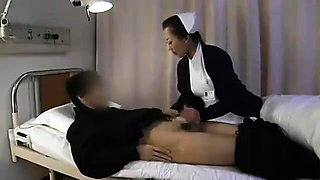 Lustful Asian nurse in uniform sits on top of a thick cock