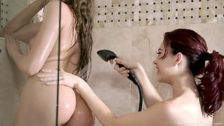 Elena Koshka and Sabina Rouge give each other orgasms in the shower