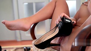 Licking and inserting her black high heels