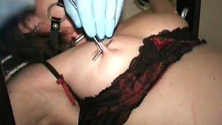 Slave getting pierced