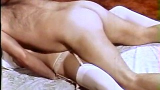 Cute blonde babe bound and fucked by two guys on the bed