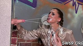 Charming wench blows at gloryhole and gets a muddy facial