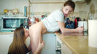 hairy muff divers lick each other in the kitchen