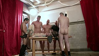 Lewd German whore Kitty Blair gets mouthfucked by two aroused studs