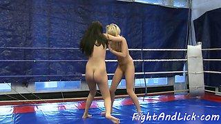 Wrestling lesbian licks pussy in closeup
