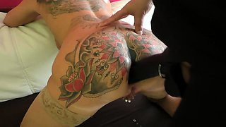 Tattooed blonde milf has a huge toy drilling her anal hole