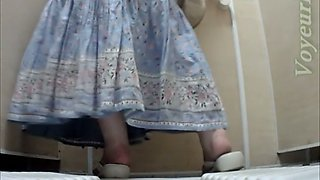 White mature lady in dress pisses in the toilet room