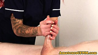 Fully clothed masseuse wanking hard dick