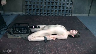 Pale skin slender white girl shackled and teased with a fuck machine