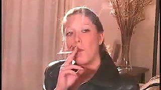 My cute redheaded girlfriend looks sexy smoking a cigarette