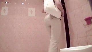 Teen girls spied in the public toilet