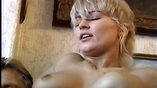 Two exquisite and sassy blonde milfs on the couch ride on big dicks
