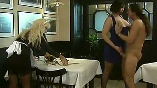 Blonde and brunette classic milfs at the table share one dick