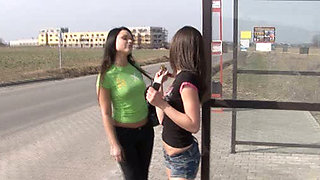 Lesbian sexy time at the quiet bus stop with two shapely Euro babes
