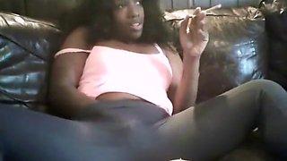 black girl smoking and playing