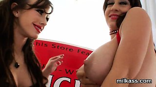Foxy lesbos fill up their big fannys with milk and squirt it