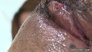 Attractive Asian chick Suzu Minamoto gets her hairy pussy shaved