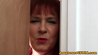Mature CFNM redhead tugging and sucking cock