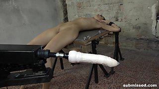 Brunette Miky Love strapped on the table and abused with fuck machine