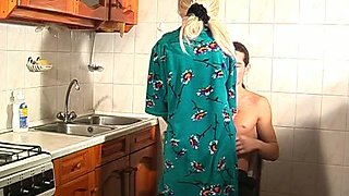Insatiable blonde girl practices petting in the kitchen