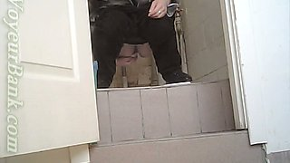 White chick in ugly baggy black pants pissing in the toilet