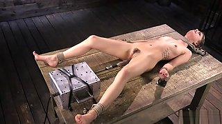 Brunette fucks machine in cums in bondage