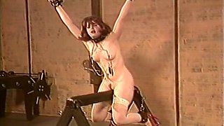 Sweet white chick with perky breasts is shackled and whipped