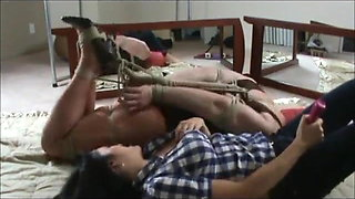 Hogtied Crossdresser with wife
