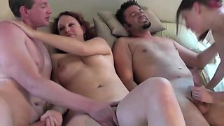 Two amateur couples having an orgy