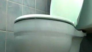 Woman films herself in bathroom toilet pissing