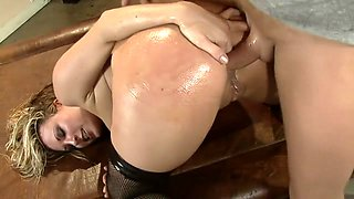 Harmony Rose gets all oiled up for some slippery couch fucking