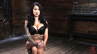 Inked slut Lily Lane strapped in a chair and abused hardcore