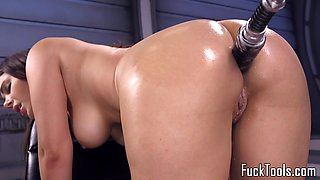 Busty babe fucked by dildo machine close up