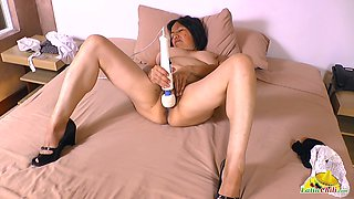 All alone mature lady is totally into using a huge vibrator for her cunt